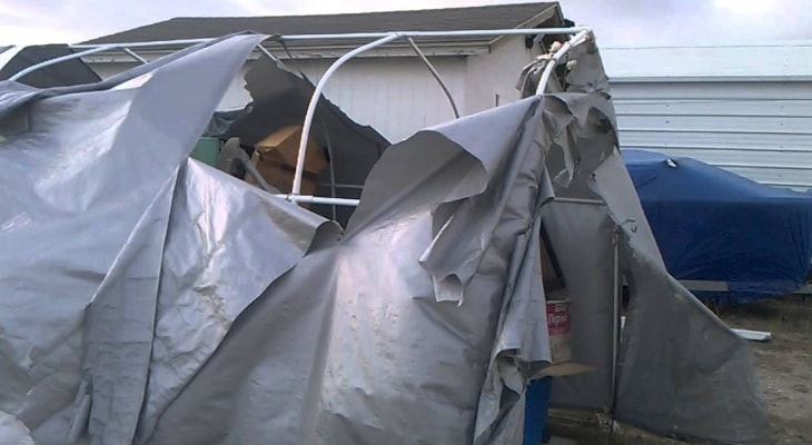 Wind damaged portable garage